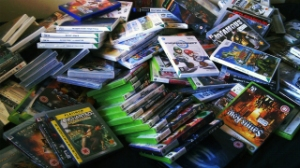 Video games, cases, boxes, pile, backlog
